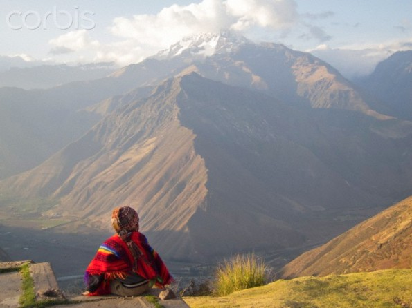 A Peruvian boy in traditional dress, and the Sacred Valley of the Incas.