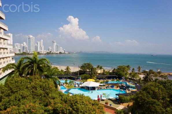 A Hilton resort with beachside pool and scenic seascape.